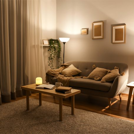 Living room in brown and beige colours in the evening with warm lighting