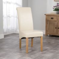 See more information about the London Wave Back Dining Chair Cream & Faux Leather