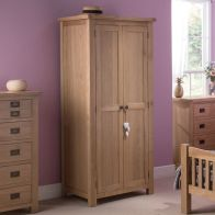 See more information about the Cotswold Tall Wardrobe Oak 2 Door