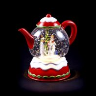 See more information about the Light Up Teapot Ornament With Santa Scene LED