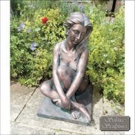 See more information about the Dorothy Garden Ornament Statue