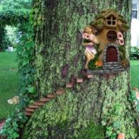 See more information about the Magical Garden Solar Powered Woodland Treehouse - Brown Door