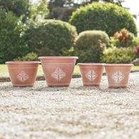 See more information about the Fleur de Lys Garden Planters Terracotta 4 Pack