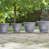 See more information about the Fleur de Lys Garden Planters Grey 4 Pack