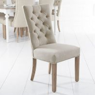 See more information about the Lancelot Curved Back Dining Chair Beige With Button Detailing